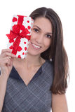 Isolated smiling pretty woman holding a gift box with red hearts Royalty Free Stock Photography