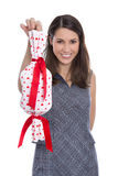 Isolated smiling pretty woman holding a gift with red hearts in Royalty Free Stock Photo