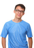 Isolated smiling standing young man blue. Isolated portrait of a smiling standing young man in blue Stock Image
