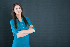 Isolated smiling woman on a dark blue background. Royalty Free Stock Images
