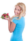Isolated smiling woman holding strawberries Royalty Free Stock Image