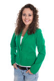 Isolated smiling young business woman in green blazer with jeans Stock Photo