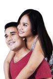 Isolated smiling young couple Stock Images