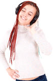 Isolated smiling young girl listening to music Stock Photo