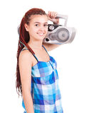 Isolated smiling young girl listening to music Stock Image