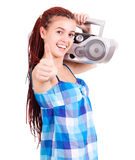 Isolated smiling young girl listening to music Royalty Free Stock Photos