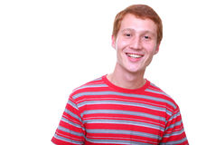 Isolated smiling young man. Isolated young smiling man in red t-shirt Royalty Free Stock Photos