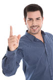 Isolated smiling young man in blue shirt and forefinger up. Satisfied young man in blue shirt and forefinger up isolated on white royalty free stock photos