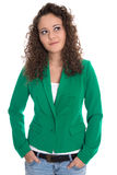 Isolated smiling young woman in green with stop curls looking si Royalty Free Stock Images