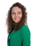 Isolated smiling young woman in green with stop curls looking si Royalty Free Stock Image