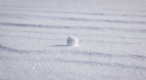 Isolated Snow Clump. Close view of one small snow clump on a snow covered landscape royalty free stock images