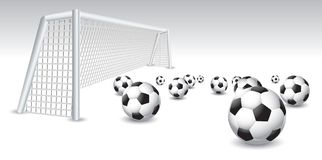 Isolated soccer balls and goal Royalty Free Stock Photo