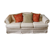 Isolated Sofa. An overstuffed sofa covered in off-white fabric with two paisley pillows and one herringbone pillow isolated on white Royalty Free Stock Photo