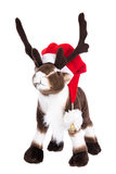 Isolated soft toy: Reindeer Rudolph with red christmas hat. Stock Images