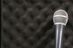 Isolated sound. Microphone against sound proof pad Royalty Free Stock Image