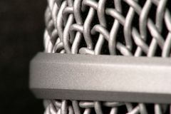 Isolated sound. Microphone against sound proof pad, close up Stock Photography