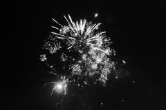 An isolated spark from a firework. An isolated spark, black and white Stock Photo