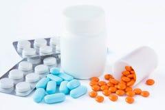 Isolated spilled pills. Isolated pills spilled and in bottle Stock Image