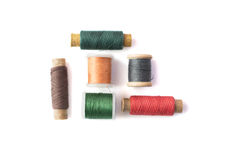 Isolated spindles with threads Stock Photo