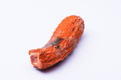 Isolated spoiled carrot Stock Image