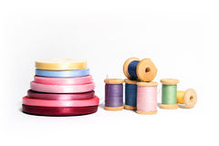 Isolated spools of colored threads with ribbon Royalty Free Stock Photography
