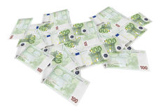 Isolated spread euro banknotes. Composite shot of many euro banknotes of 100 euros spread on table in perspective Royalty Free Stock Photos