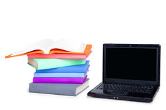 Isolated Stack of books and laptop Royalty Free Stock Photo