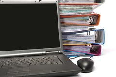 Isolated stack of folders with laptop computer Stock Photo