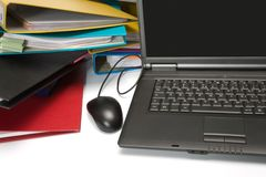 Isolated stack of folders with laptop computer Royalty Free Stock Image