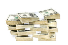 Isolated Stacks of Money. Huge stack of prop money. Bundled in $10000 dollar stacks. Isolated on white Stock Photo