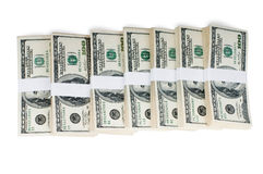 Isolated Stacks of Money. Huge stack of prop money. Bundled in $10000 dollar stacks. Isolated on white Royalty Free Stock Photography