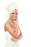 Isolated standing woman wearing towel Royalty Free Stock Photography