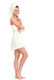 Isolated standing woman wearing towel Royalty Free Stock Photo