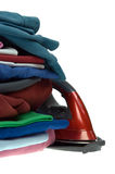 Isolated steam iron and stack shirts Stock Image
