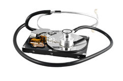 Isolated stethoscope on the hard disk drive Stock Photography