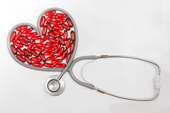 Isolated stethoscope with red heart shaped Royalty Free Stock Images