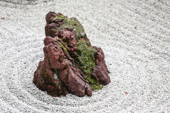 Isolated Stone in a Japanese Zen Garden with White Sand and Moss Royalty Free Stock Image
