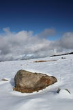 Isolated stone in a snowy landscape in Pyrenees Royalty Free Stock Images