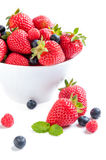 Isolated strawberry with berries and raspberries on white backgr Stock Photos