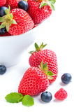 Isolated strawberry with berries and raspberries on white backgr Royalty Free Stock Photo
