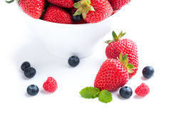 Isolated strawberry with berries and raspberries on white backgr Royalty Free Stock Photography