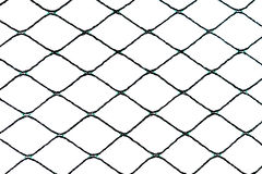 Isolated Stretched Nylon Net Detail. An isolated dark green nylon net woven in rhomboidal shape  against a white background with high contrast and a nice level Royalty Free Stock Images