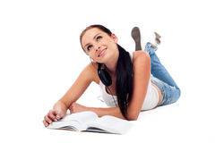 Isolated student lie on the floor. With book, dreaming Stock Photos