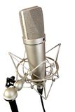 Isolated studio microphone. Isolated chrome classical professional microphone with crab support Royalty Free Stock Photos