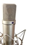 Isolated studio microphone. Isolated chrome classical professional microphone with crab support Royalty Free Stock Image