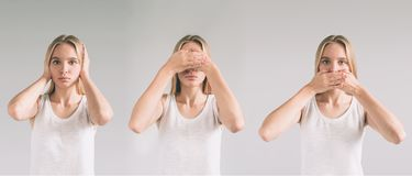 Isolated studio shot of a Caucasian woman in the See No Evil, Hear No Evil, Speak No Evil poses. Royalty Free Stock Photo
