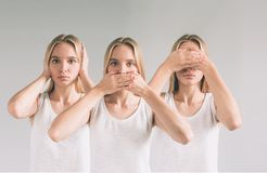 Isolated studio shot of a Caucasian woman in the See No Evil, Hear No Evil, Speak No Evil poses. Royalty Free Stock Photography