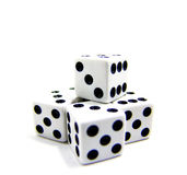 Isolated dice on white background. Isolated studio shot of four dice on white background Royalty Free Stock Photos