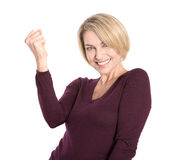 Isolated successful and happy older woman in pullover. Royalty Free Stock Photos