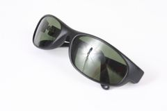 Isolated sunglasses. A pair of isolated black sunglasses Stock Image